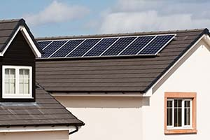 Photovoltaic Solar panels Mounted on the tiled roof of a modern residential or private home